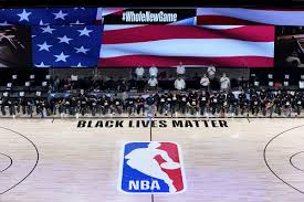 NBA PLAYERS kneel for the  national anthem ahead of a playoff game. Photo courtesy of the Associated Press.