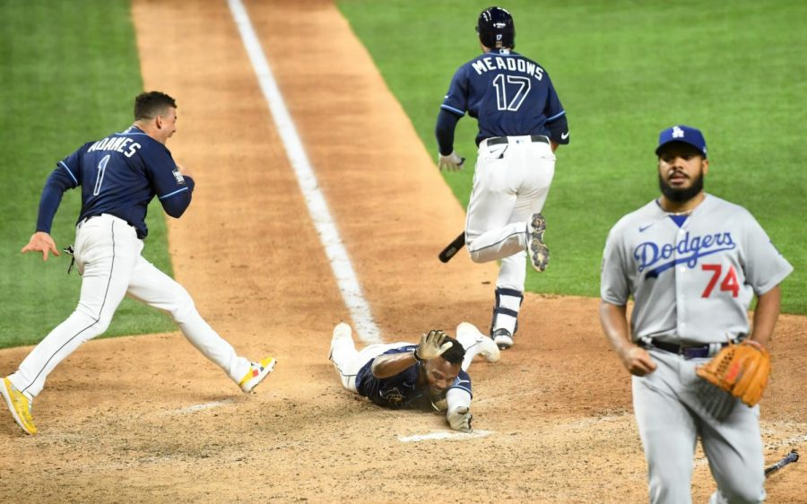 Randy Arozarena scores the winning run in Game 4 for the Rays. Photo courtesy of the LA Times.