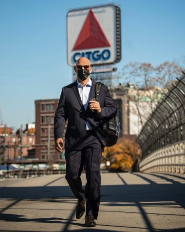 Alex Cora recreating a photo from his first hiring walking away from Fenway Park.