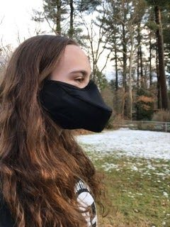 Carly Robinson sports a singer's mask.