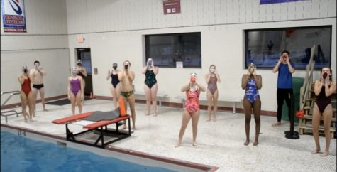 L-S Swim and Dive seniors cheer on swimmers in a socially-distant manner.