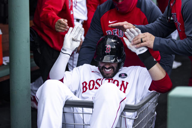 The Red Sox celebrate a J.D. Martinez home run in the dugout. Photo by Billie Weiss.