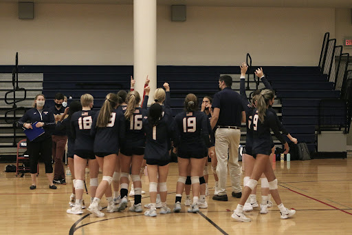 The LS Girls Volleyball team gathers with Coach Falcone. Photo courtesy of Sophie Ward.